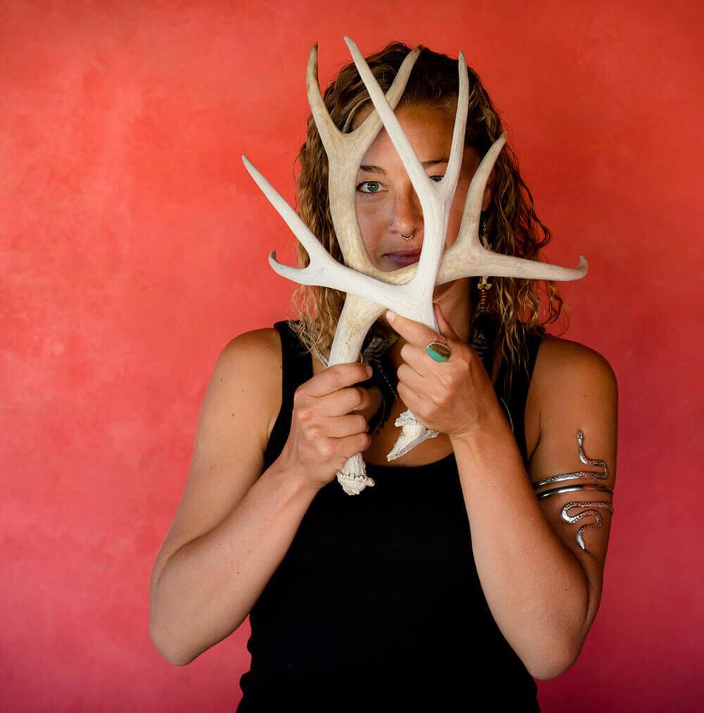 Jen Antill holding deer antlers